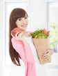 beautiful young woman with apple and vegetables