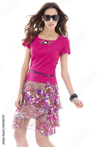 young girl in fashion dress wearing sunglasses posing