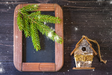 Christmas  concept. Chalk boards and birdhouse.