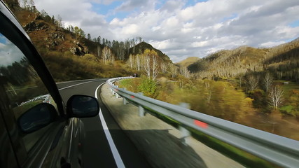 Driving a car on the serpentine mountain in the Altai (POV)