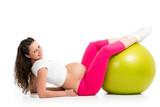 Pregnant woman excercises with gymnastic fit ball