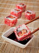 The concept of Japanese food - sushi and soy sauce on the mat