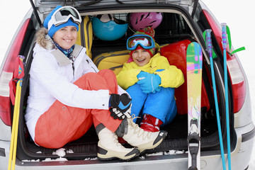 Ski - family with ski equipment ready for travel
