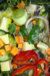 Fresh fish and vegetable soup close-up background