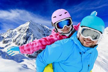 Ski, winter, sun and fun - family enjoying winter