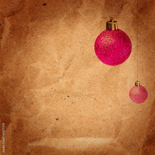 Vintage Christmas card with glittering balls on old recycled bro
