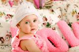 Portrait of very sweet little child sitting like a princess