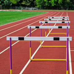 The concept of sport - the barriers on the treadmill stadium.