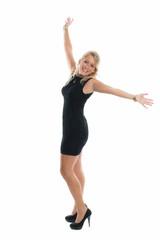 Tanzende blonde Frau im Minikleid