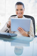 Cheerful sophisticated businesswoman holding tablet computer