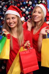 Frauen mit Geschenktüten