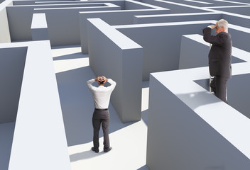 Two businessmen standing in maze