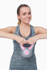 Cheerful woman working with a kettle bell