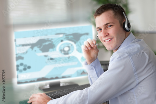 Cheerful businessman using futuristic interface hologram