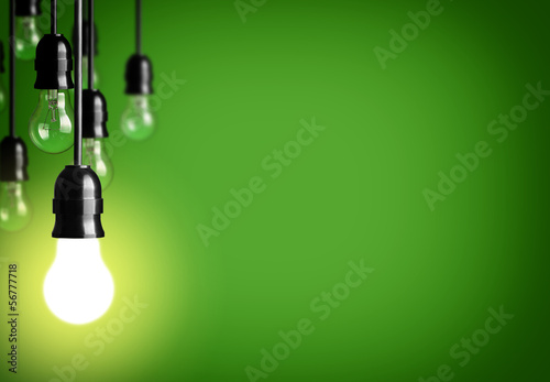 Idea concept on green background. - 56777718