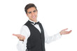 Handsome young waiter making a certain gesture