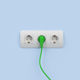 Wall outlets with green plug attached