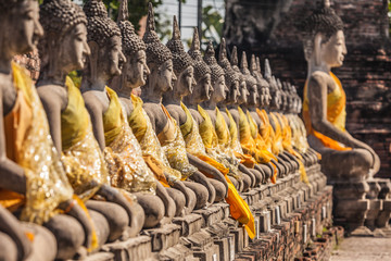 Row of Buddha statues at the temple in Thailand