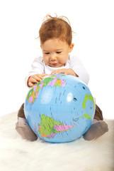 Baby boy with world globe