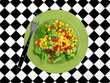 A green plate of vegetables with a fork on a tablecloth