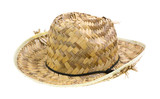 An old frayed straw hat on a white background