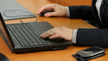 hands typing on a keyboard, to correct