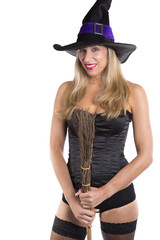 Sexy blonde haired witch with broomstick