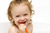 Little toddler holding a tooth brush