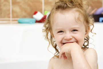 Little toddler enjoying bathing
