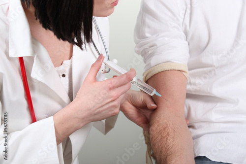 a nurse giving an injection