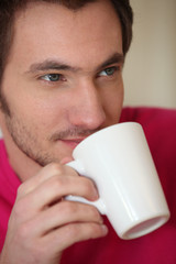 Man drinking from a mug