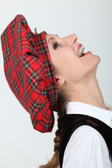 Woman in a Scottish tam o'shanter hat