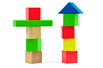 Wooden toy colorful building blocks on white background