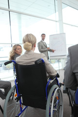 Woman in a wheelchair at meeting