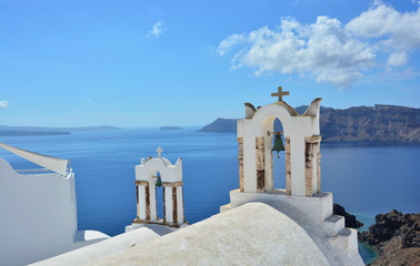 White church in Santorini with views of the sea.