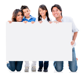 Happy family with a placard