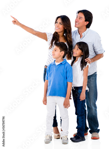 Happy family pointing away