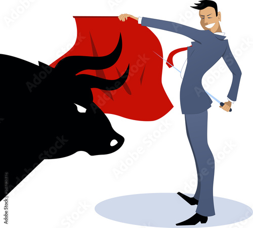 Businessman torero fighting a bull