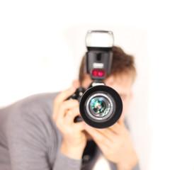 junger Mann mit Kamera