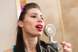 Beautiful girl with red lips in room with microphone in Studio