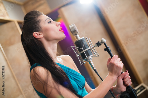 Girl with red lips holding a microphone and singing