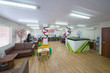 Large office with sofas for relaxation and layout of buildings