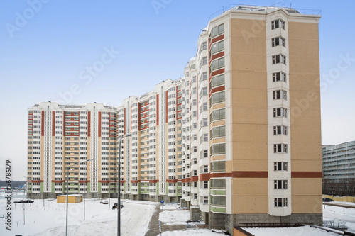 Large new residential apartment building of colored bricks