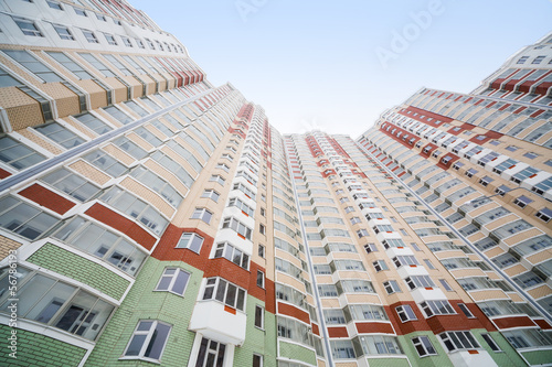 Large residential apartment building of colored bricks