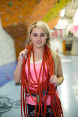 portrait of young girl with rope around her neck on climbing gym
