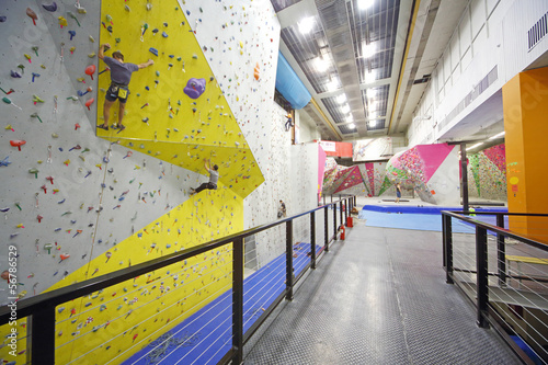 Men involved in climbing in a climbing gym