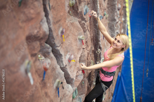 Cute smiling girl engaged in climbing