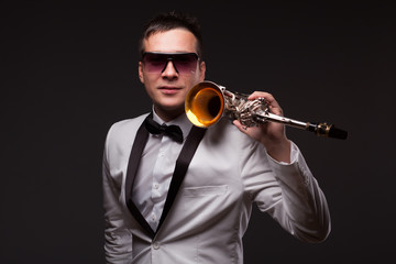 Portrait of guy with sax in suit and sunglasses