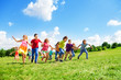Many kids running in the field