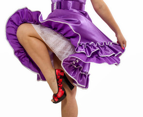 Female legs under a violet skirt